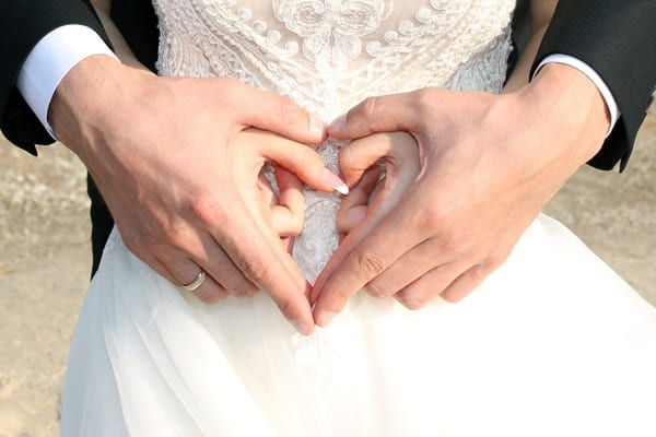 married hands in heart
